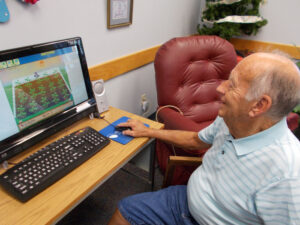 man-playing-computer-games-st-johns-cc-image