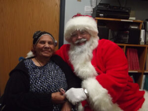 woman-smiling-with-santa-image-st-johns-community-care